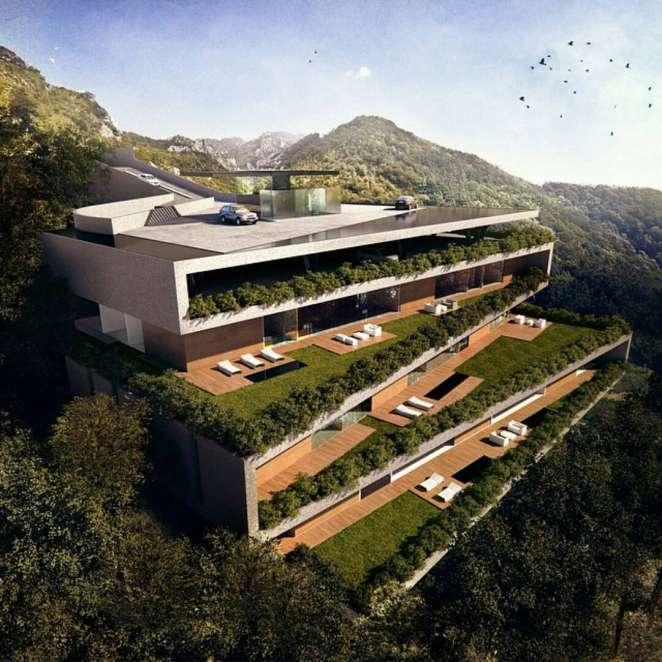 Este diseño de casa integra los jardines con los pisos, realmente espectacular.
